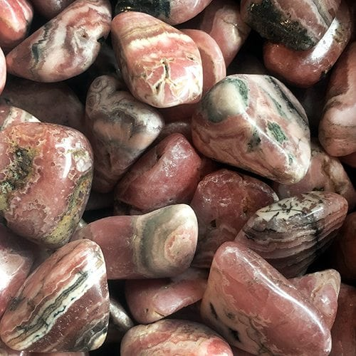 Rhodochrosite at Dreaming Goddess in Poughkeepsie, NY. Tumbled Rhodochrosite.